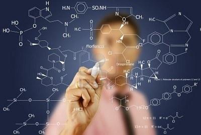 10753703-asian-teacher-writing-scientific-formula-on-the-whiteboard